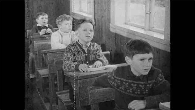 1950s: Schoolroom.  Students recite lesson together.  Mountains.  Sea.  Church.  Rowboats move through water.