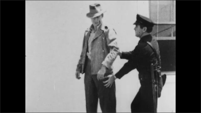 1940s: police officer patting down man