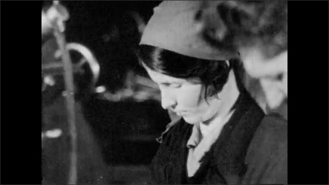 RUSSIA 1940s: men and women title. Man and woman work in factory. Close up of lady's face.  Boy and lady mill wood in factory