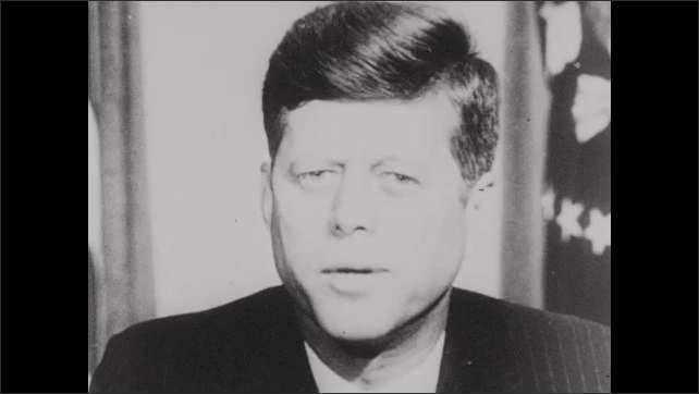 1960s: Close up of John F Kennedy speaking at desk.