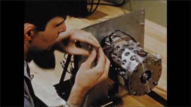 1950s: Animation of magnetic drum. Man assembling magnetic drum.