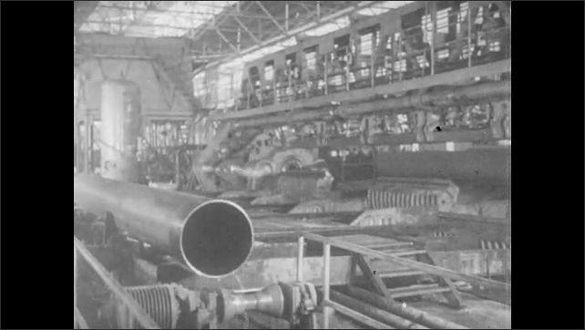 RUSSIA 1960s: Metal tube is rolled by machine, pushed on conveyor belt. Train pulls into station. People board train.
