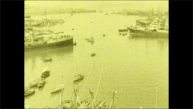 1920s: Words on screen. Ships of all varieties move through and park in large port in Greece.