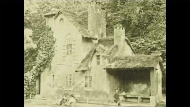 PARIS 1920s: Girl runs through small villa next to pond. People walk around buildings around pond. Intertitle.