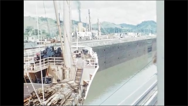 1950s: Ship moves through Panama Canal.
