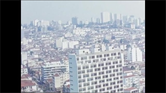 1950s: Large city with tall buildings.