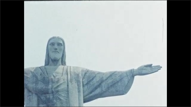 1950s: Christ the Redeemer statue. Boat on the bay.