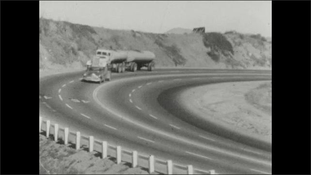 1950s: Car drives on neighborhood road. Cars and trucks drive on curvy highway. Man spins rock on string.