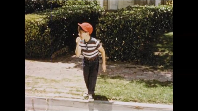 1950s: UNITED STATES: boy runs to window. Boy looks through window of house. Boy runs to edge of curb. Boy crosses road. Ship and passengers celebrate departure.