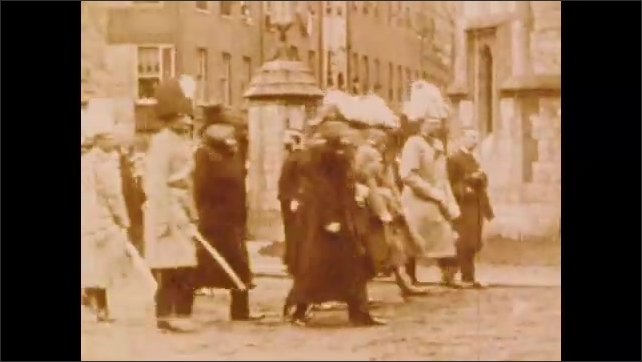1900s: People walk through city in funeral parade.