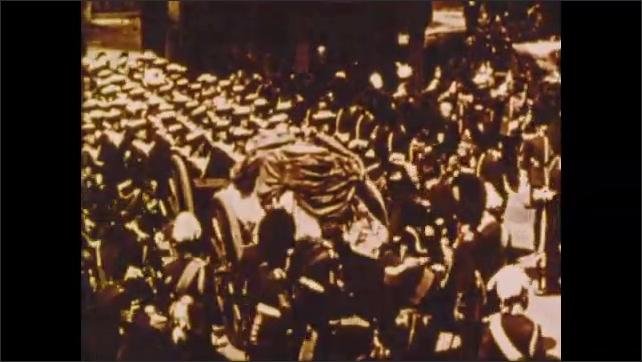 1900s: Soldiers stand around casket on cart.