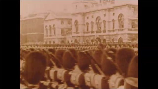 1900s: Busy city street.  Bridge.  Soldiers march and ride horses.  Fancy carriage in parade.