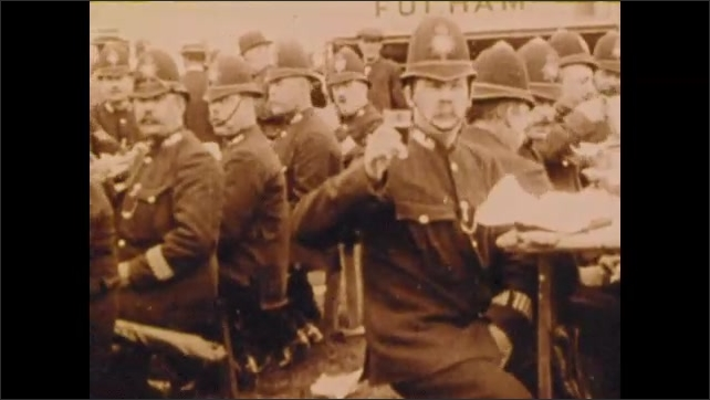 1900s: People cheer at boat race.  Men ride horses.  Policemen sit and eat.  Women march in parade.