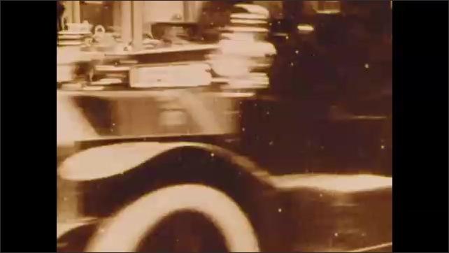 1900s: Women march in parade.  Traffic.  Police officers arrest women.