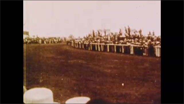 1900s: Women hold signs.  Horse race.  Horse and rider fall.  Spectators go under ropes.