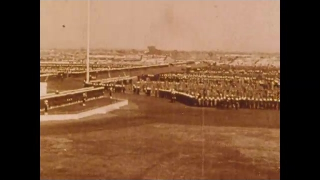 1900s: Fairgrounds.  Soldiers stand and march.