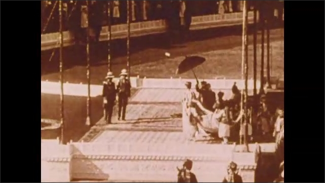 1900s: Royal parade.  People ride elephants.