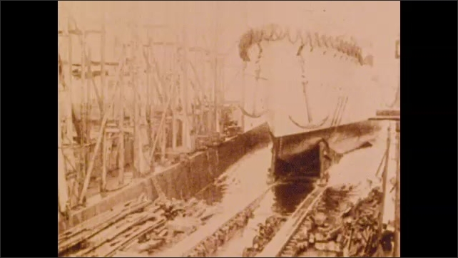 1900s: Sailors march.  Ship comes out of dry dock.  Men on ship.  Bridge.