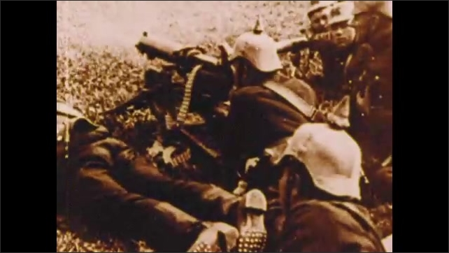 1900s: Troops stand in rows.  Military officials.  Soldiers fire weapons.