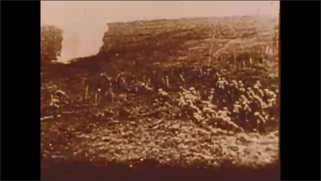 1900s: Soldiers jump out of foxhole and run.  Men fire weapons.