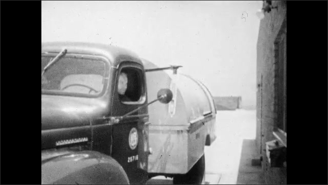 1950s: Garbage truck pulls up to facility scale and worker exits cab. Dispatcher looks at scale needle and records weight of truck. Map of garbage truck routes on wall.