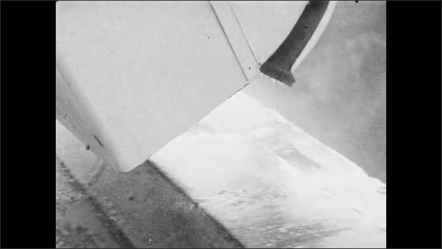 1950s: Food waste and water falls from garbage truck bin into hopper. Debris falls from bin as water flushes through it.