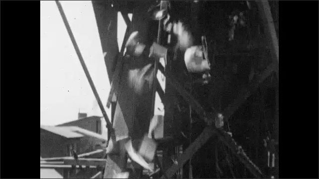 1950s: Bins dump cans into metal chute. Cans rain down from chute into large hopper below.