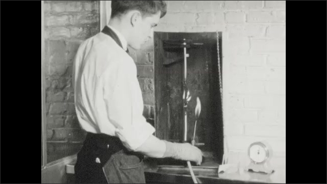 1940s: Lab, equipment parts move, man holds brass knobs. Man tests equipment in box, holds flame close. Chemistry lab, woman examines flasks.