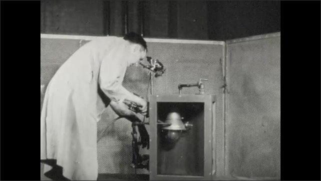 1940s: Lab, drum revolves, needle records pressure. Lighting fixture in test chamber, man turns knobs, flash of light.