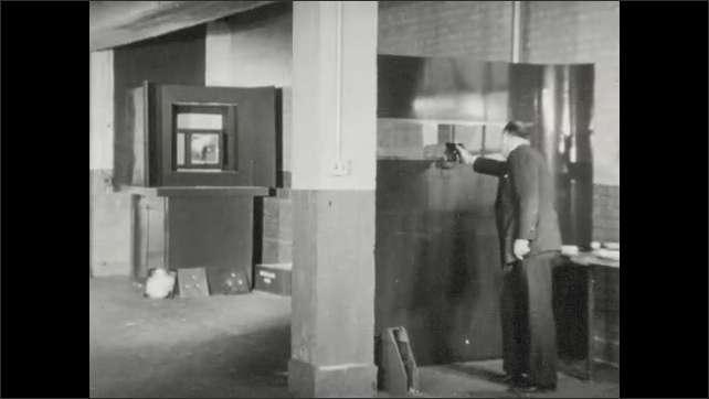 1940s: Lab, blow torch, safe, sparks fly. Indoor shooting range, man tests bullet resisting glass, impact, glass cracks, man fires gun, carries clipboard. Man loads gas cartridge into gun.