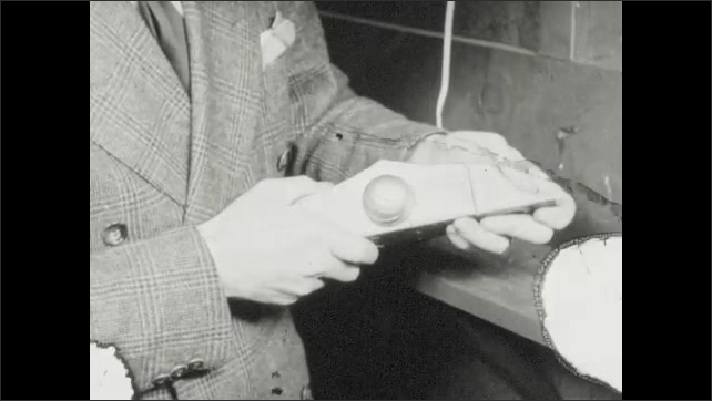 1940s: Lab, man loads gas cartridge into gun. Men examine equipment, man stands, holds clipboard, takes notes. Pipes, tanks, man turns control valve.