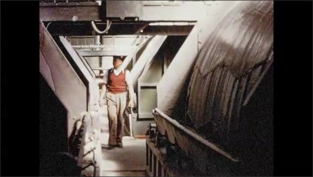 1950s SOUTH AFRICA: Workers transport gold via underground railway through mine. Worker inspects molten gold. Molten gold poured into molds.