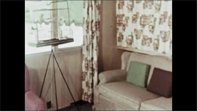 1960s: Mobile homes in trailer park. Mobile home with garden. Living room and kitchen of mobile home.