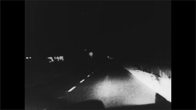 1960s: car driving down road at night then swerves and hits two people