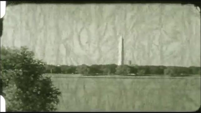 1940s: Long shot of building across lake. Long shot of Washington Monument. View of lake.