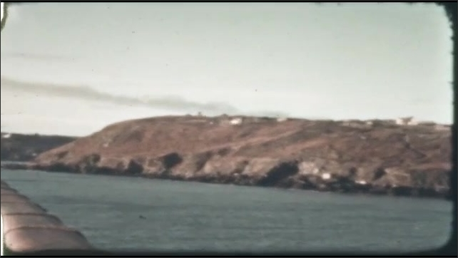 1940s: UNITED STATES: boats on water. Bird flies in bay. Deck of ship. Seagulls fly over sea.