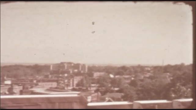 1940s: UNITED STATES: view across roofs on buildings. Panoramic view of town.