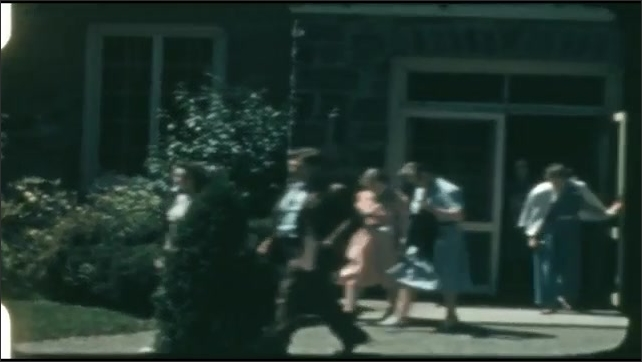 1940s: People leave building and walk across path.