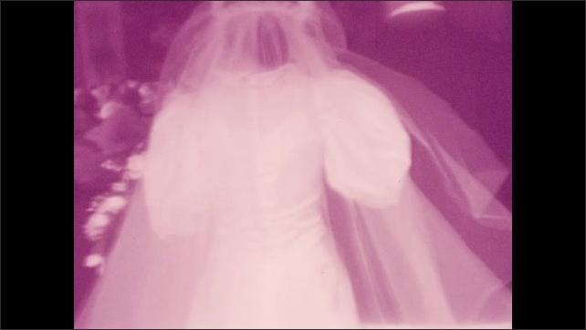 1940s: Flower girl walks through doors. Bride and escort walk down the aisle.