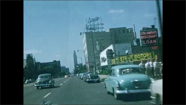 1940s: Car drives down road.  City.  Country.  Highway.