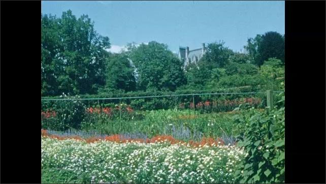 1940s: Garden.  Biltmore Estate.  Car drives down road.