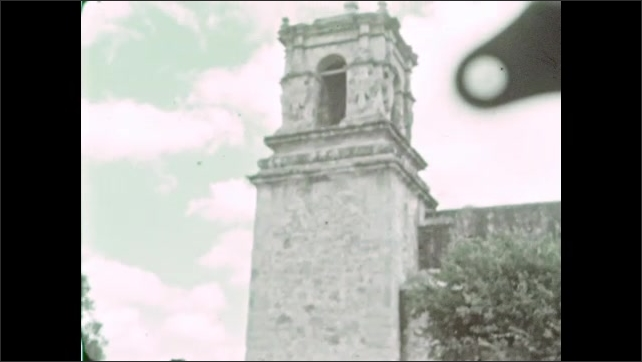 1930s: Exterior of the San Antonio Mission. Cars parked outside of the Mission walls.