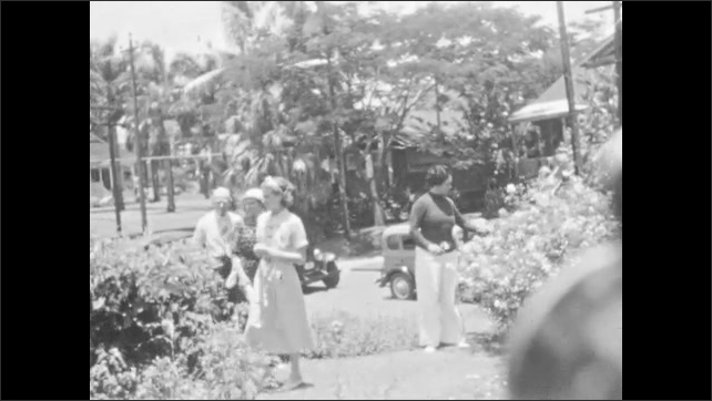 1930s: People walk around outside, look at plants.