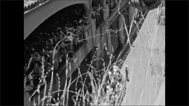 1930s: HAWAII: streamers between dock and ship. View from ship