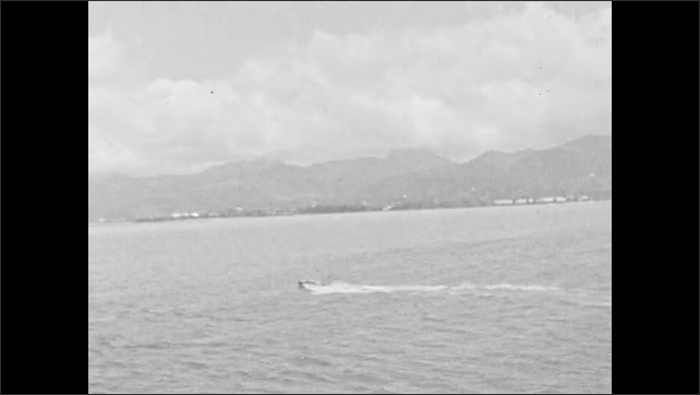 1930s: HAWAII: ladies relax in chairs on deck of ship. Lady smiles at camera. Speed boat on sea. Ladies walk along deck of ship.