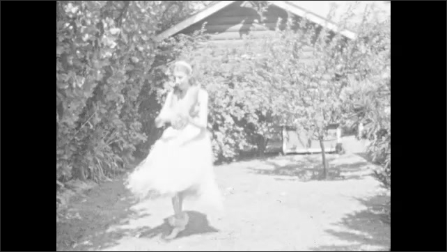 1930s: HAWAII: girl dances in house. Girl dances the hula