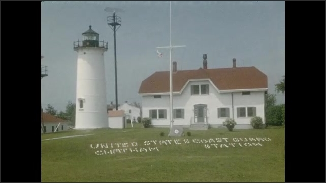 1950s: Driving down road, passed restaurant. Driving by water. Coast Guard station and lighthouse.