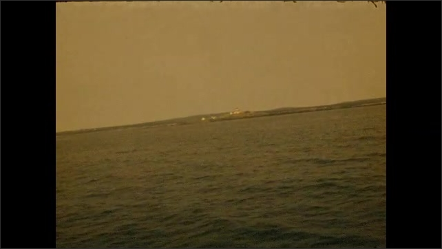 1950s: Boating in large body of water.