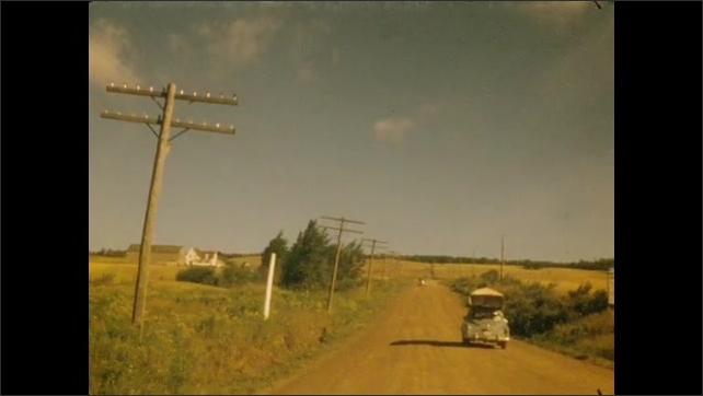 1950s: Rolling in car up Magnetic Hill.