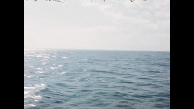 1950s: Boating out on ocean.